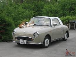 nissan figaro for sale fabulous fun and funky figaro in rare and beautiful topaz mist colour