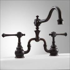kitchen bridge kitchen faucet cross handles delta wall mount