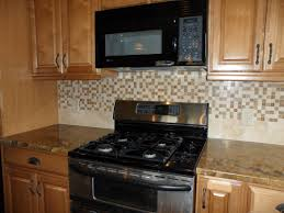 kitchen desaign mosaic tiles and medium square tiles combination
