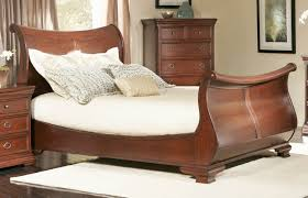 a sleigh bed frame brings comfort and elegance to the bedroom