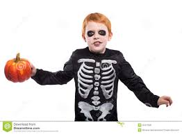 portrait of little red haired boy wearing halloween skeleton