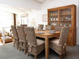 black wicker dining set with arm rest also round black table