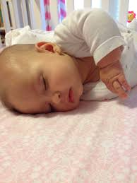 Baby Sleeping In A Crib by How To Soothe Crying Babies With Swaddling And White Noise