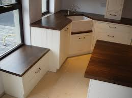 painted kitchen with walnut worktops cream cabinets terracotta
