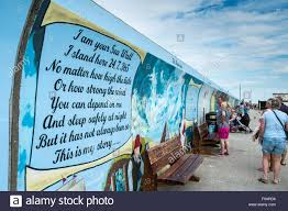 a mural commemorating the canvey island flood painted on the sea a mural commemorating the canvey island flood painted on the sea wall at canvey island essex