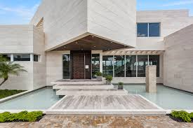 extraordinary spec home in coral gables with floating master there s also a rooftop terrace and an infinity pool and spa condores capital is also currently building homes in pinecrest and gables estates