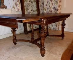 superb antique oak gothic extending dining table with carved