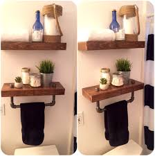 Floating Shelves For Bathroom by Floating Shelves With Pipe Towel Holder Mounted In The Bathroom