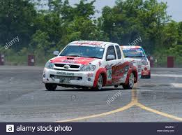 mitsubishi toyota toyota and mitsubishi pickup trucks racing on a racetrack in