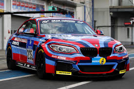 bmw race cars bmw m235i racing dressed as art car to race on the ring this