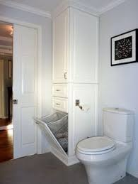 bathroom cabinet with built in laundry her built in shelves over drop in bathtub via orilla bathrooms