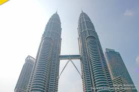 day to night at petronas twin towers kuala lumpur day 1 in