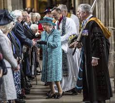 the queen presents maundy thursday coins and moves pensioners to