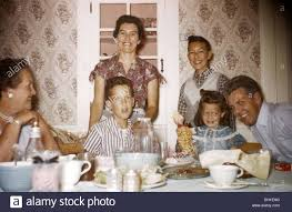family at the dinner table during the 1950s vintage wallpaper stock