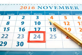 thanksgiving day date on calendar and pen on white stock photo
