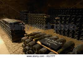 Burgundy Wine Cellar - in the underground wine cellar a pile of thousands of bottles of