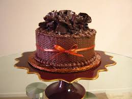 a german chocolate cake with handmade chocolate ruffles and a