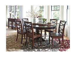 ashley furniture porter round dining room pedestal table with leaf