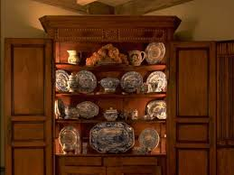 lighting antique corner cabinets with custom light systems