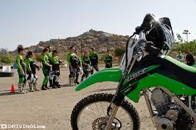 kawasaki motocross bikes kawasaki shows us how to ride dirt bikes drivingline
