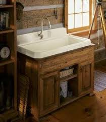 kohler gilford 22 in vitreous china utility sink in white wall