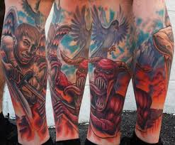 infamous tattoo company tattoos color good over evil leg