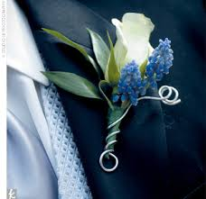 blue boutonniere joe and his groomsmen donned ivory roses teamed with sprigs of