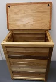 nice wood laundry hamper with simple canadian baseball handcarved