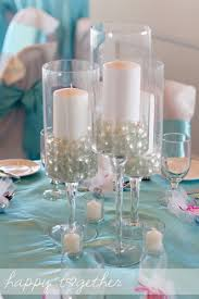 tall u0027wine glass u0027 holders with clear marbles and pillar candles