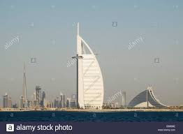 skyline of dubai with burj al arab hotel and burj khalifa tower in