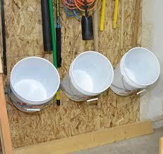 Garage Workshop Organization Ideas - installing a bucket storage rack for garage hometalk