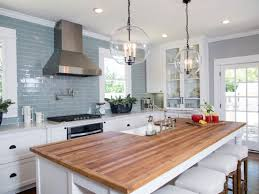 white kitchen island with butcher block top grey ceramic wall tiles with stylish butcher block top white
