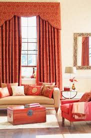 scappoled cornice with traversing drapery in the color coral