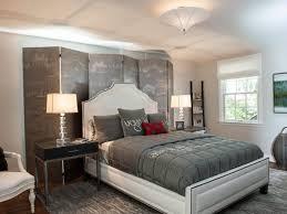 black and white interior design bedroom dark purple pillows plain