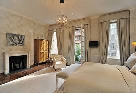 traditional master bedroom with interior wallpaper by the corcoran
