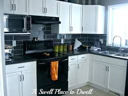 kitchens with white cabinets and black appliances white cabinets black appliances salmaun me