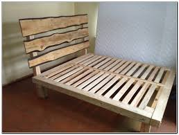 cheap pallet wood homemade bed frame with headboard for bachelor jpg