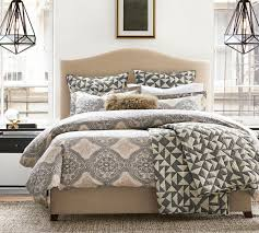 raleigh upholstered camelback bed with nailhead pottery barn au