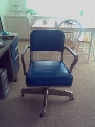 blue desk chairs partially refinished tanker desk chair with blue upholstry