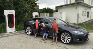 tesla model s charging road tripping with kids a lot of luggage and a tesla model s