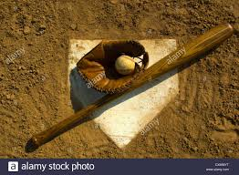 home plate vintage wooden baseball bat glove and baseball on home plate