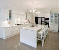 white kitchen wood floor white varnished wooden cabinet mirror