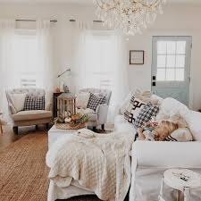 cozy living room with a gorgeous chandelier loving the front door