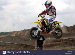 motocross race 6 year old races on a honda 50 cc motorcyle in motocross race
