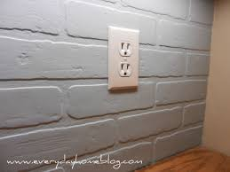 budget friendly painted brick backsplash at kitchen backsplash