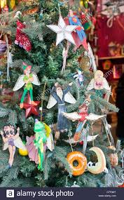 whimsical modern handicraft tree decorations including comic strip