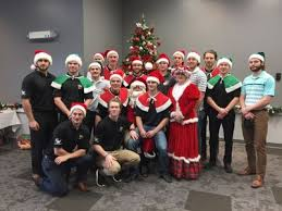 Christmas Party Host - hockey players host a christmas party for district special needs