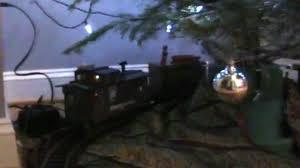 dog chases toy train around christmas tree youtube