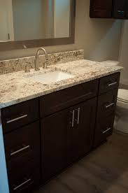 gorgeous dark cabinets exotic granite countertop and karndean