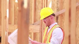 builder looks at plans for the future building or house concept